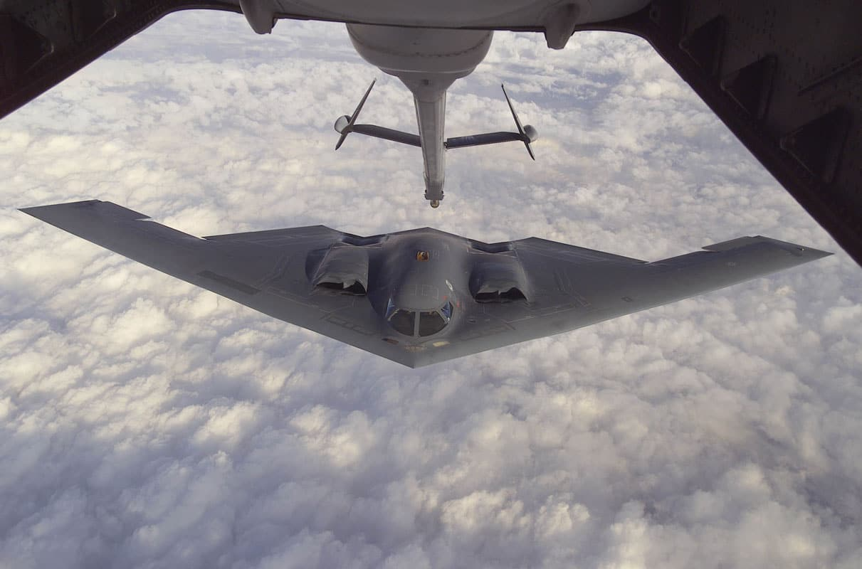 The B-2 Spirit approaches the boom of a McGuire Air Force Base, New Jersey KC-10A Extender during a Capstone orientation flight. Capstone is a Joint Airborne/Air Transportability Training mission providing interservice training for the wartime application of airlift. Through Capstone, senior level officers are able to observe the significance of airlift and its role in all military operations