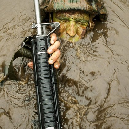 A Delta Company Officer Candidates breaks the surface of Murky Water