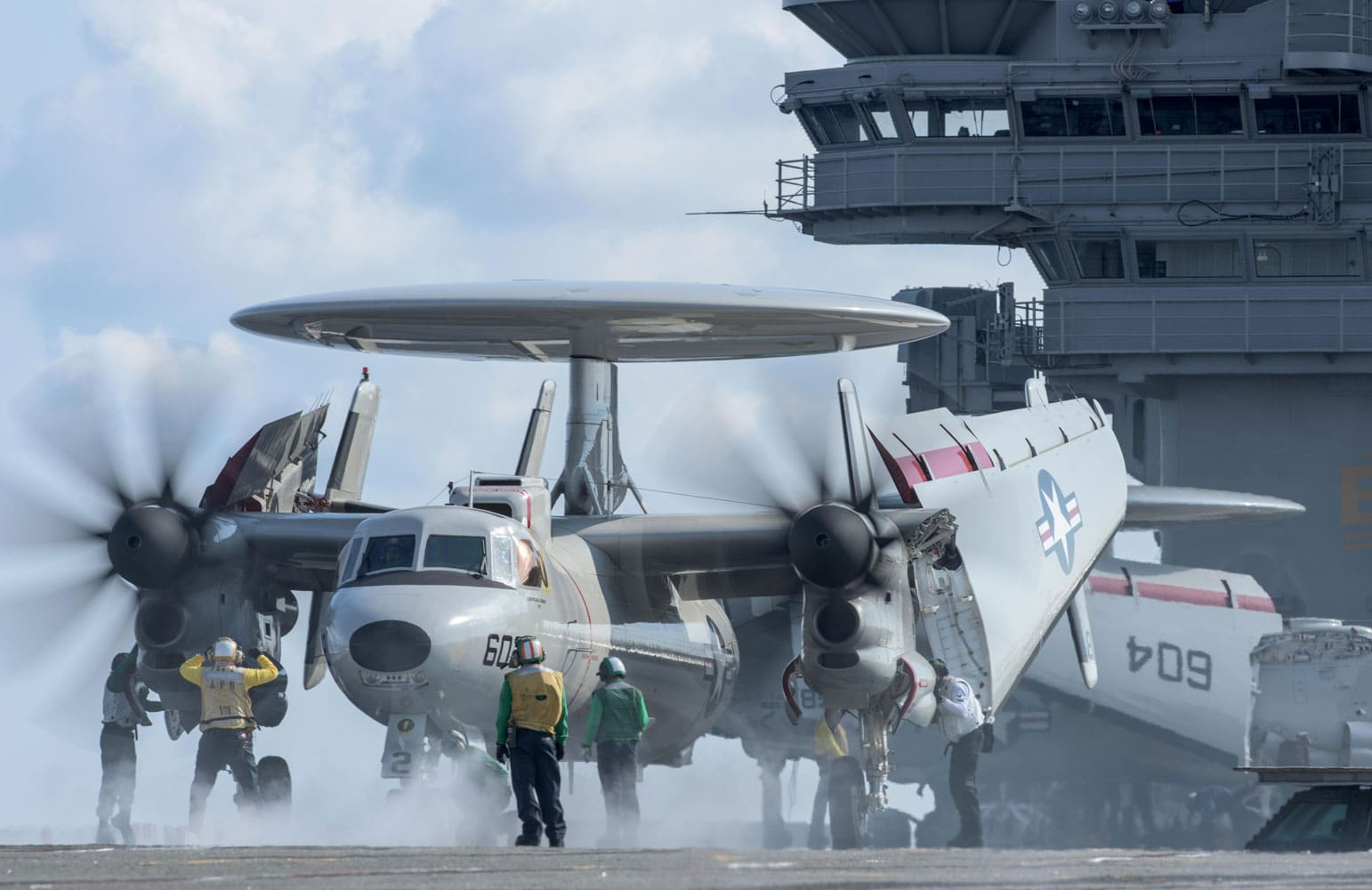 "U.S. Sailors prepare to launch an E-2D Hawkeye assigned to the ""Tigertails"" of Airborne Early Warning Squadron (VAW) 125 from the flight deck of the Navy's forward-deployed aircraft carrier, USS Ronald Reagan (CVN 76). Carrier Air Wing 5 is embarked on Ronald Reagan and conducting flight-deck qualifications to ensure the ship and air wing is able to safely launch and recover aircraft. Ronald Reagan, the flagship of Carrier Strike Group 5, provides a combat-ready force that protects and defends the collective maritime interests of its allies and partners in the Indo-Asia-Pacific region."