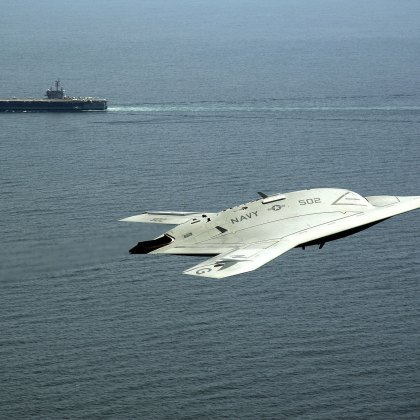 An X-47B Unmanned Combat Air System demonstrator flies near the aircraft carrier USS George H.W. Bush (CVN 77) after launching from the ship in the Atlantic Ocean. The George H.W. Bush became the first aircraft carrier to successfully catapult launch an unmanned aircraft from its flight deck.