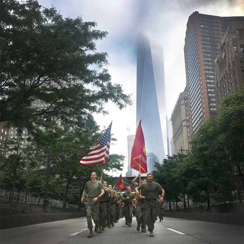One World Trade Center stands tall as Marines and sailors motivate the city on their way to the 9/11 Memorial during the Freedom Run at Fleet Week New York.
