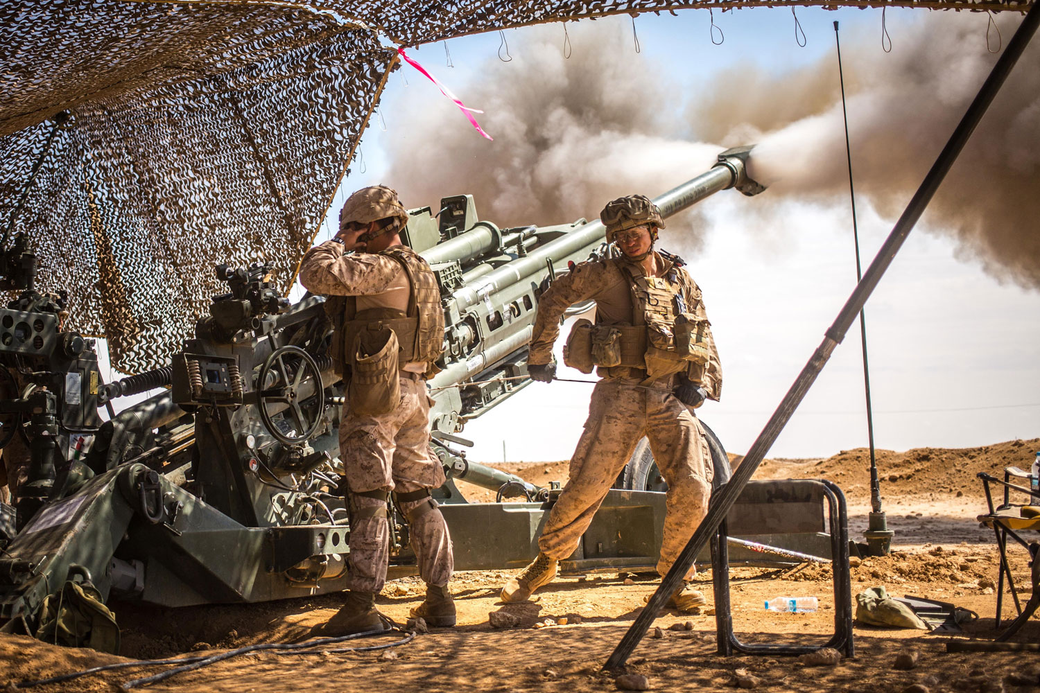 U.S. Marines with the 11th Marine Expeditionary Unit fire an M777 Howitzer during a fire mission in northern Syria as part of Operation Inherent Resolve. The unit provided 24/7 support in all weather conditions to allow for troop movements, to include terrain denial and the subduing of enemy forces.
