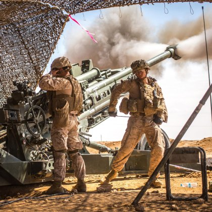 U.S. Marines with the 11th Marine Expeditionary Unit fire an M777 Howitzer