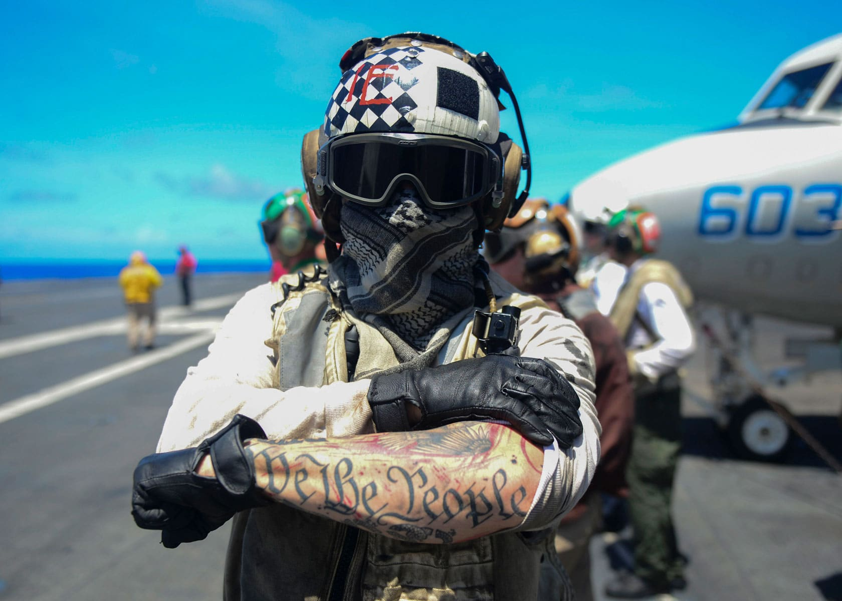 Aviation Electrician's Mate 2nd Class Lucas Mclean, assigned to the United States Navy Black Knights of Strike Fighter Squadron (VFA) 154, displays his patriotic body art aboard the aircraft carrier USS Nimitz.
