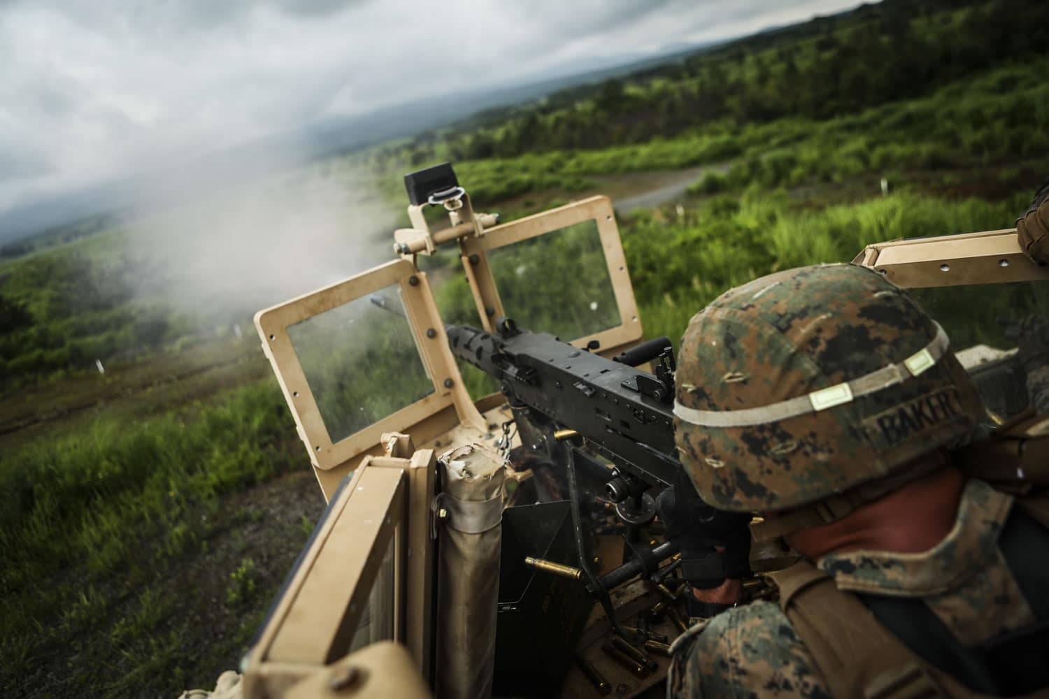 Pfc. Brett M. Baker, a Haskell, New Jersey native and anti-tank missile-man with Combined Anti-Armor Team 2, Weapons Company, 1st Battalion, 3rd Marine Regiment, fires .50 caliber rounds on a mounted M2 .50 caliber machine gun down range during Exercise Fuji Viper aboard Camp Fuji, Japan.
