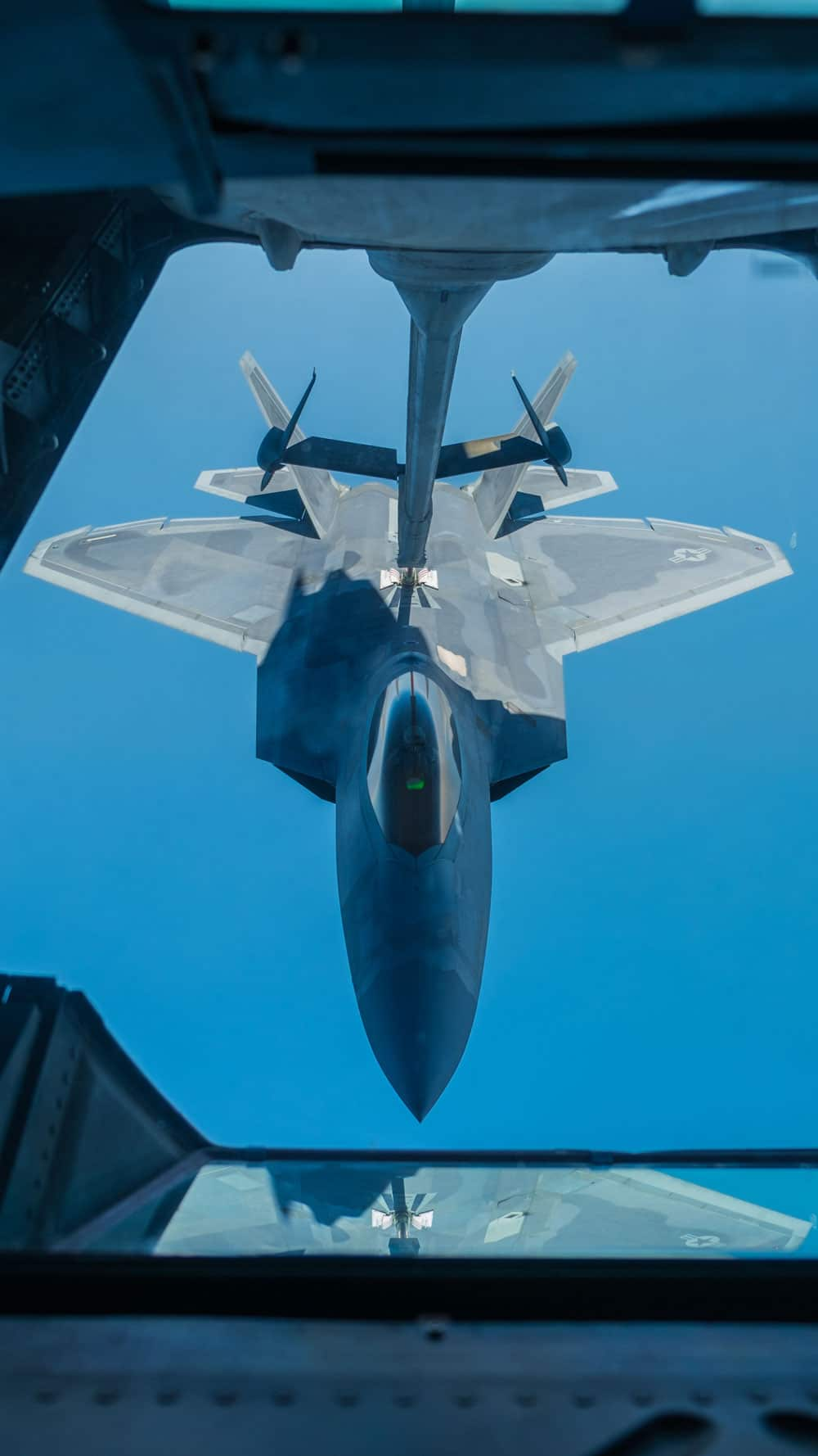 USAF 27th Expeditionary Fighter Squadron pilot flies an F-22 Raptor up to a 908th Expeditionary Air Refueling Squadron KC-10 Extender in the skies over southwest Asia. As part of the Air Force Global Strike Task Force, members of the 27 EFS take the fight directly to ISIS.