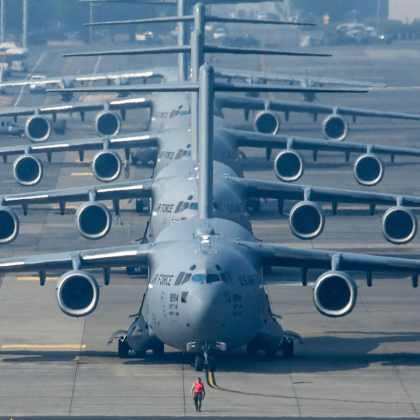 Four C-17 Globemaster III's and a C-130 Hercules line up in preparation for Mobility Guardian's elephant walk, Joint Base Lewis-McChord, Washington. More than 3,000 Airmen, Soldiers, Sailors, Marines and international partners converged on the state of Washington in support of Mobility Guardian.