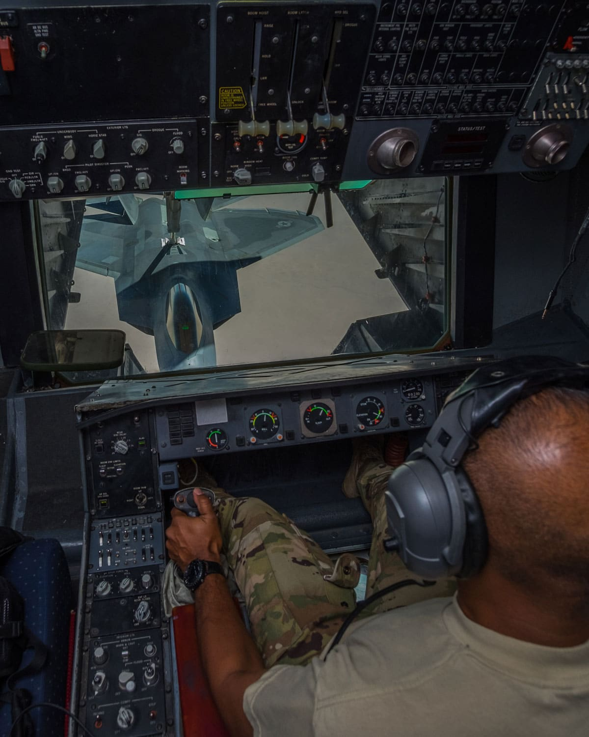 Master Sgt. Kingsley, 908th Expeditionary Air Refueling Squadron boom operator, refuels a 27th Expeditionary Fighter Squadron F-22 Raptor from a KC-10 Extender in the skies over southwest Asia. By refueling the 27 EFS, 908 EARS Airmen directly support Combined Joint Task Force-Operation Inherent Resolve's fight against ISIS.