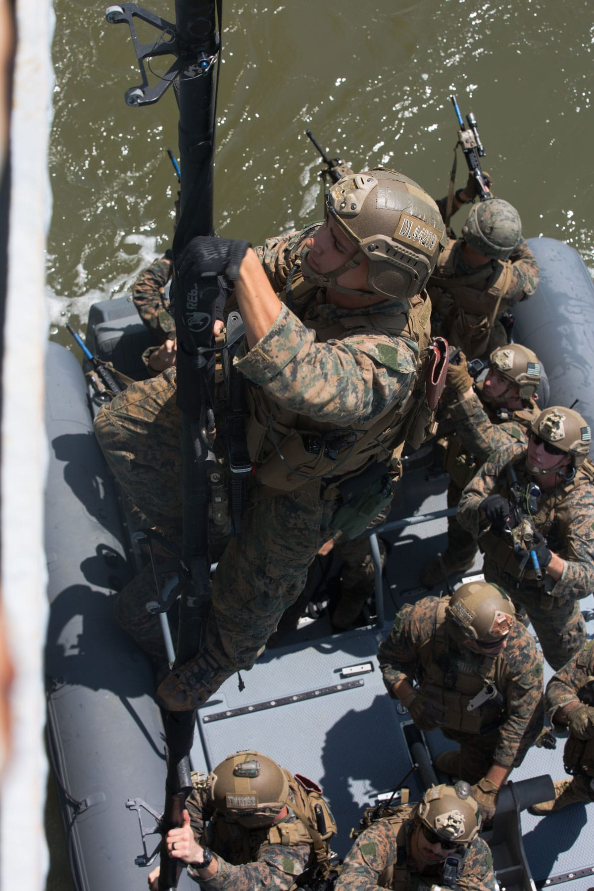 A U.S. Marine with the Maritime Raid Force, 26th Marine Expeditionary Unit, climbs a ladder during visit, board, search and seizure training at Fort Eustis, VA.