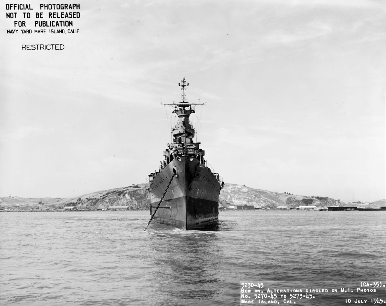 The United States Navy Portland-class heavy cruiser USS Indianapolis (CA 35) at anchor off the Mare Island Navy Yard, in Northern California following its final overhaul. The release status of this photograph has changed to released since the stamp indicating that this photo is not released was applied.