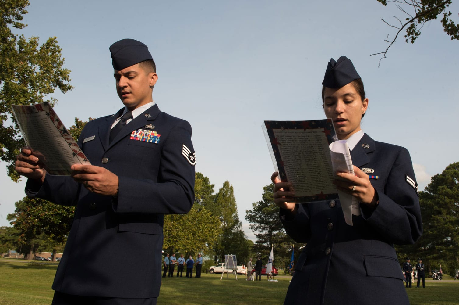 "U.S. Air Force Staff Sgt. Stephen Irizarry, 440th Supply Chain Operations Group equipment technician and Airman First Class Melanie Irizarry 733d Logistics Readiness Squadron supply apprentice, honor the victims of terrorist attack on Sept. 11, 2001 and those who have paid the ultimate sacrifice since, during ""The Reading of The Names"" at Gosnolds Hope Park, Hampton, Va., Sept. 11, 2017."