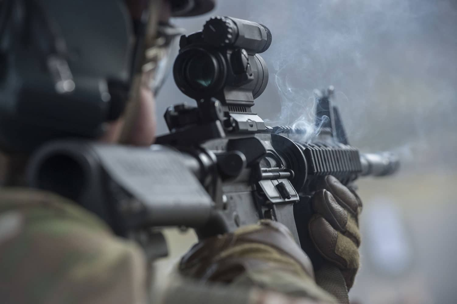 Smoke emanates from U.S. Air Force Senior Airman Brian Melendrez's M4 carbine during live-fire sustainment training at Joint Base Elmendorf-Richardson, Alaska.