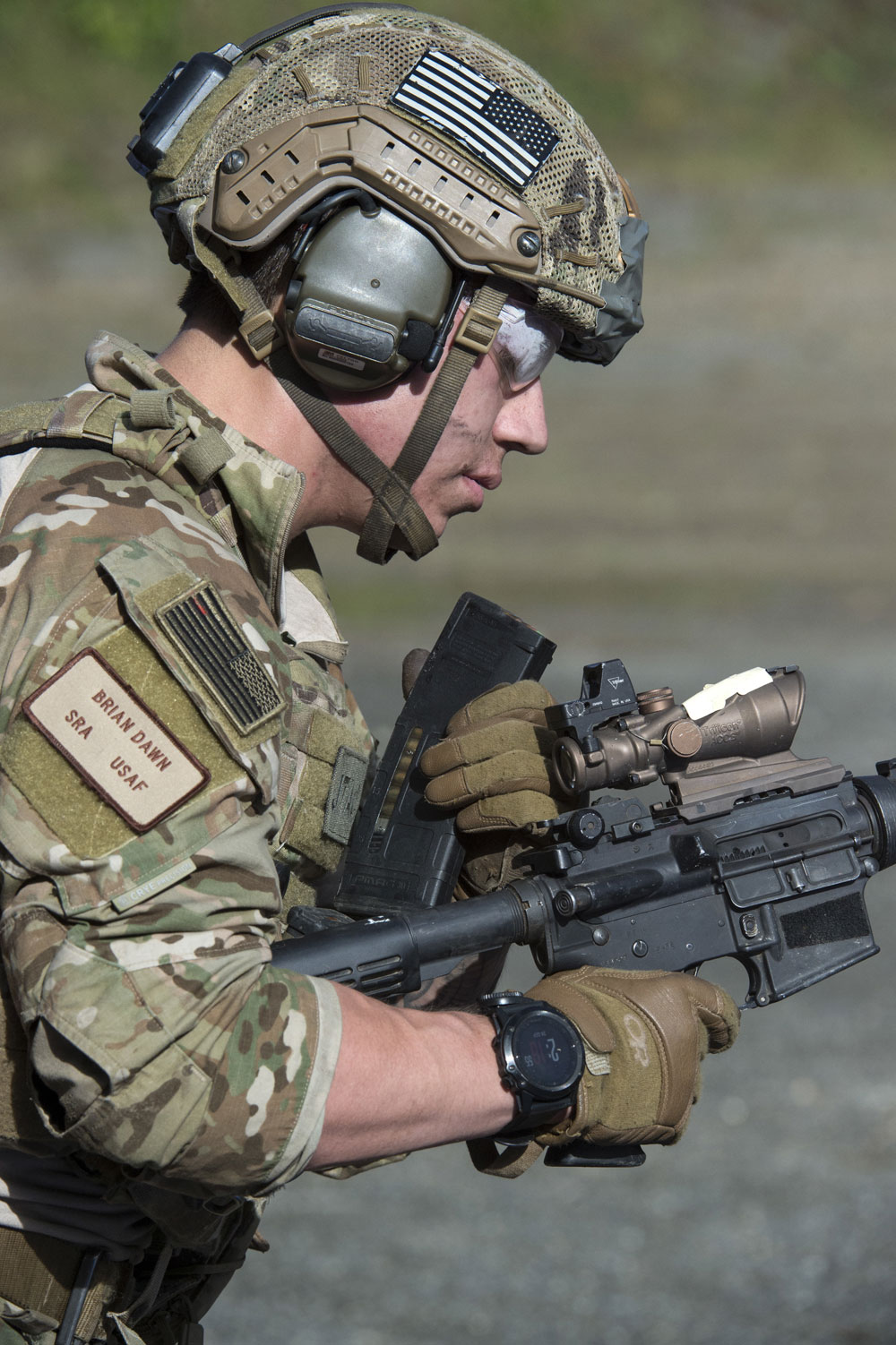 U.S. Air Force Senior Airman Brian Dawn, a tactical air control party specialist assigned to the 3rd Air Support Operations Squadron, examines his M4 carbine while clearing a malfunction during live-fire sustainment training at Joint Base Elmendorf-Richardson, Alaska.