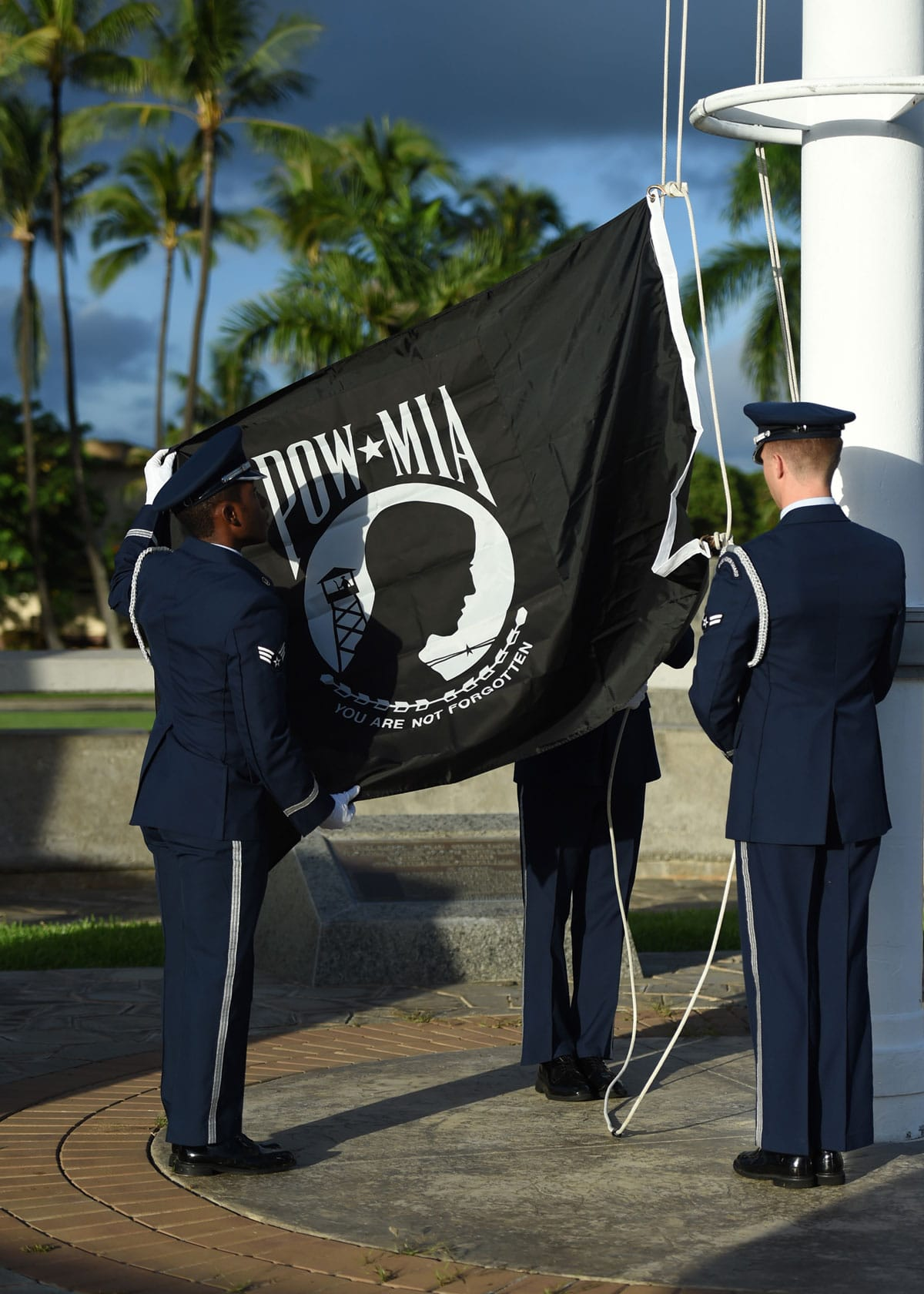 USAF Airmen From Joint Base Pearl Harbor-Hickam's Honor Guard raise the POW-MIA flag during a POW/MIA reveille ceremony, held on JBPHH, Hawaii. The ceremony started this year's POW-MIA week, which honors the 82,473 missing or unaccounted for military members in all branches of armed services.