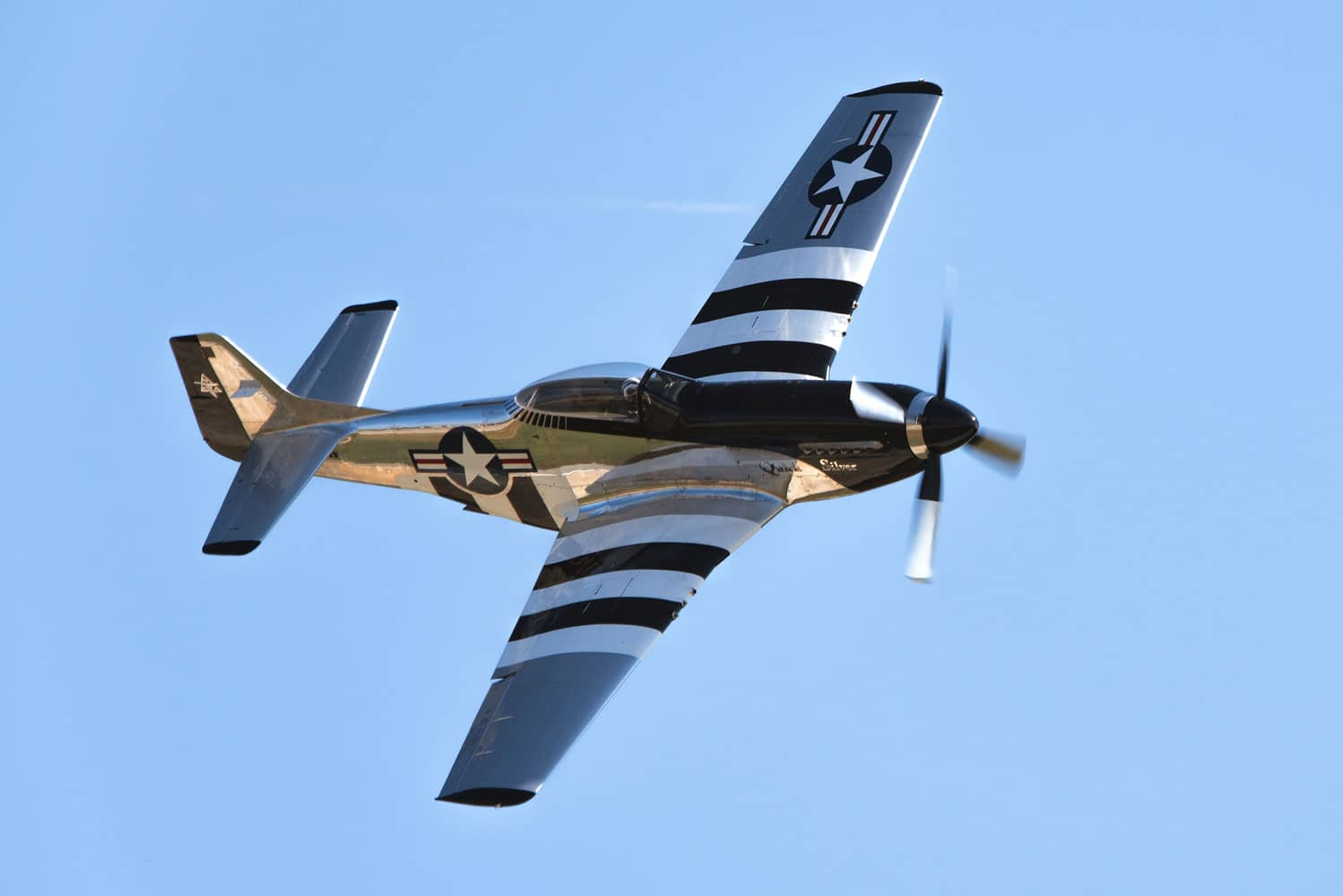 A QuickSilver P-51 Mustang flies over Joint Base Andrews, Md., during the 2017 Andrews Air Show: Air and Space Expo.
