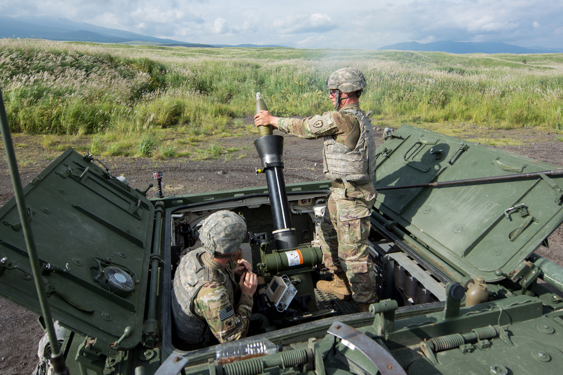 Spc. Holden Rogers, assigned to Headquarters, Headquarters Company, 3rd Battalion, 21st Infantry Regiment, 1st Stryker Brigade Combat Team, 25th Infantry Division, loads ordnance into a RMS6L 120mm mortar system on a M1129 Mortar Carrier as part of exercise Orient Shield 2017 at Camp Fuji, Japan.