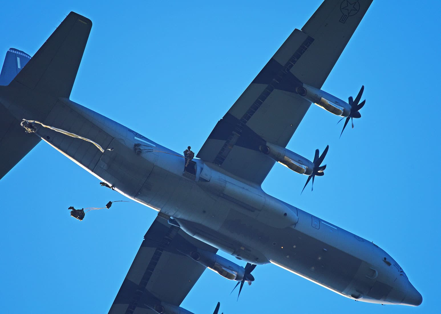 U.S. Army Paratroopers assigned to the 173rd Brigade Support Battalion, 173rd Airborne Brigade, conduct an airborne operation from a U.S. Air Force 86th Air Wing C-130 Hercules aircraft at Frida Drop Zone in Pordenone, Italy.