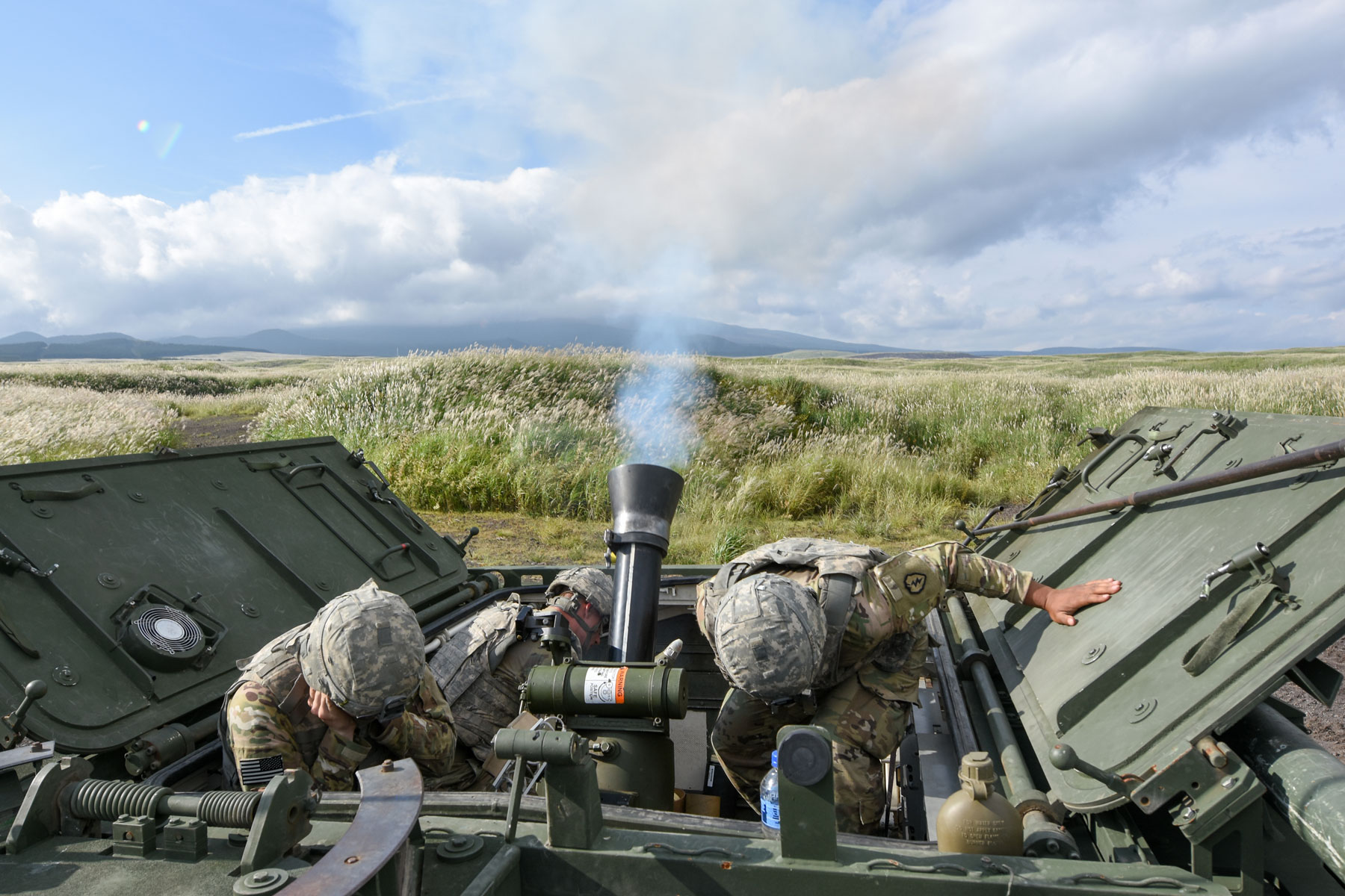 U.S. Army Soldiers assigned to Headquarters and Headquarters Company, 3rd Battalion, 21st Infantry Regiment, 1st Stryker Brigade Combat Team, 25th Infantry Division, conduct a live fire exercise with a RMS6L 120mm mortar system on a M1129 Mortar Carrier.
