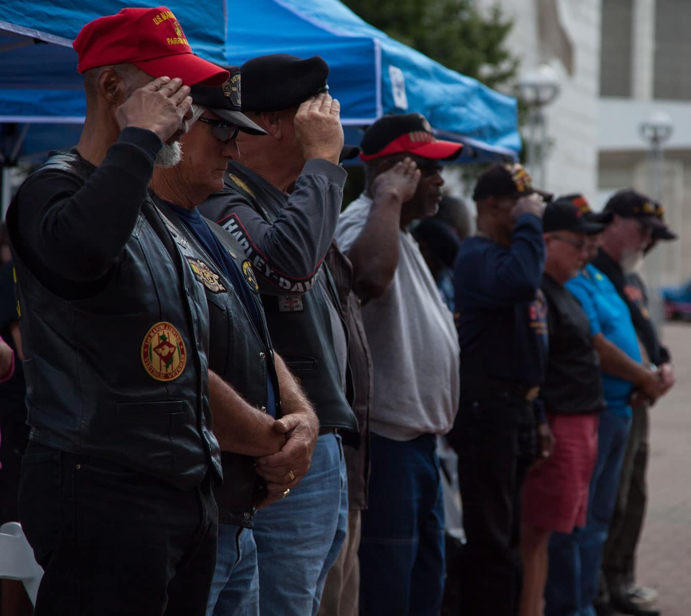 Detroit Vietnam veterans salute to colors during a Vietnam veteran pinning ceremony as part of Marine Week Detroit.