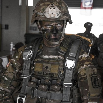 A paratrooper from the First Rock Paratroopers 173rd Airborne Brigade United States Army is rigged and ready to air insert into a hostile environment.
