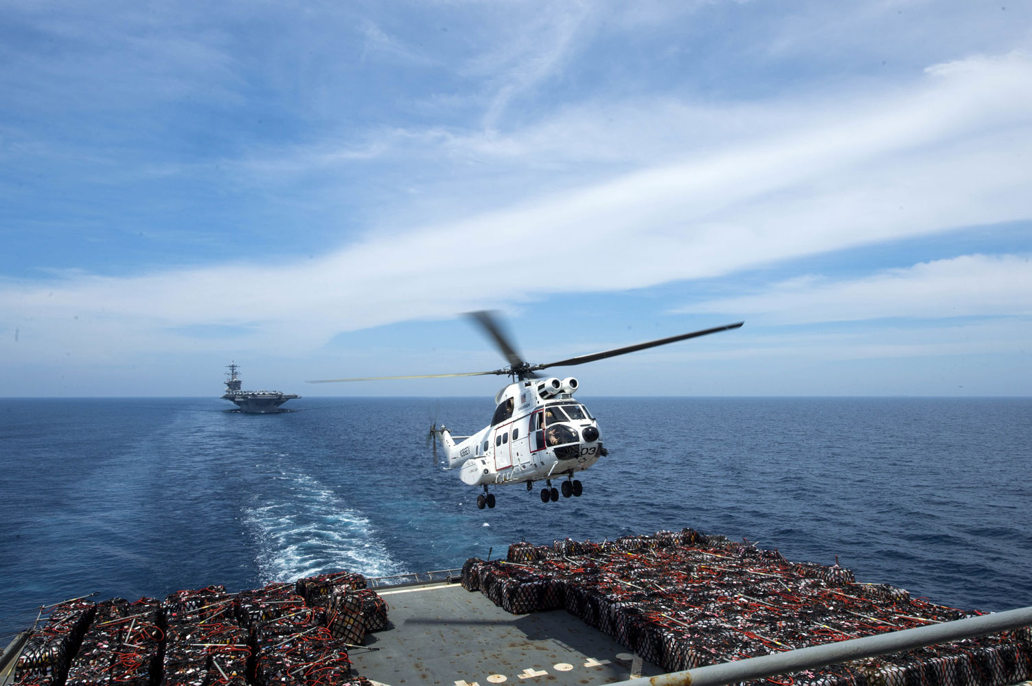 An SA-330J Puma Helicopter assigned to the Military Sealift Command dry cargo and ammunition ship USNS Amelia Earhart lifts off from the flight deck during a vertical replenishment at sea with USS Theodore Roosevelt in the Western Pacific.