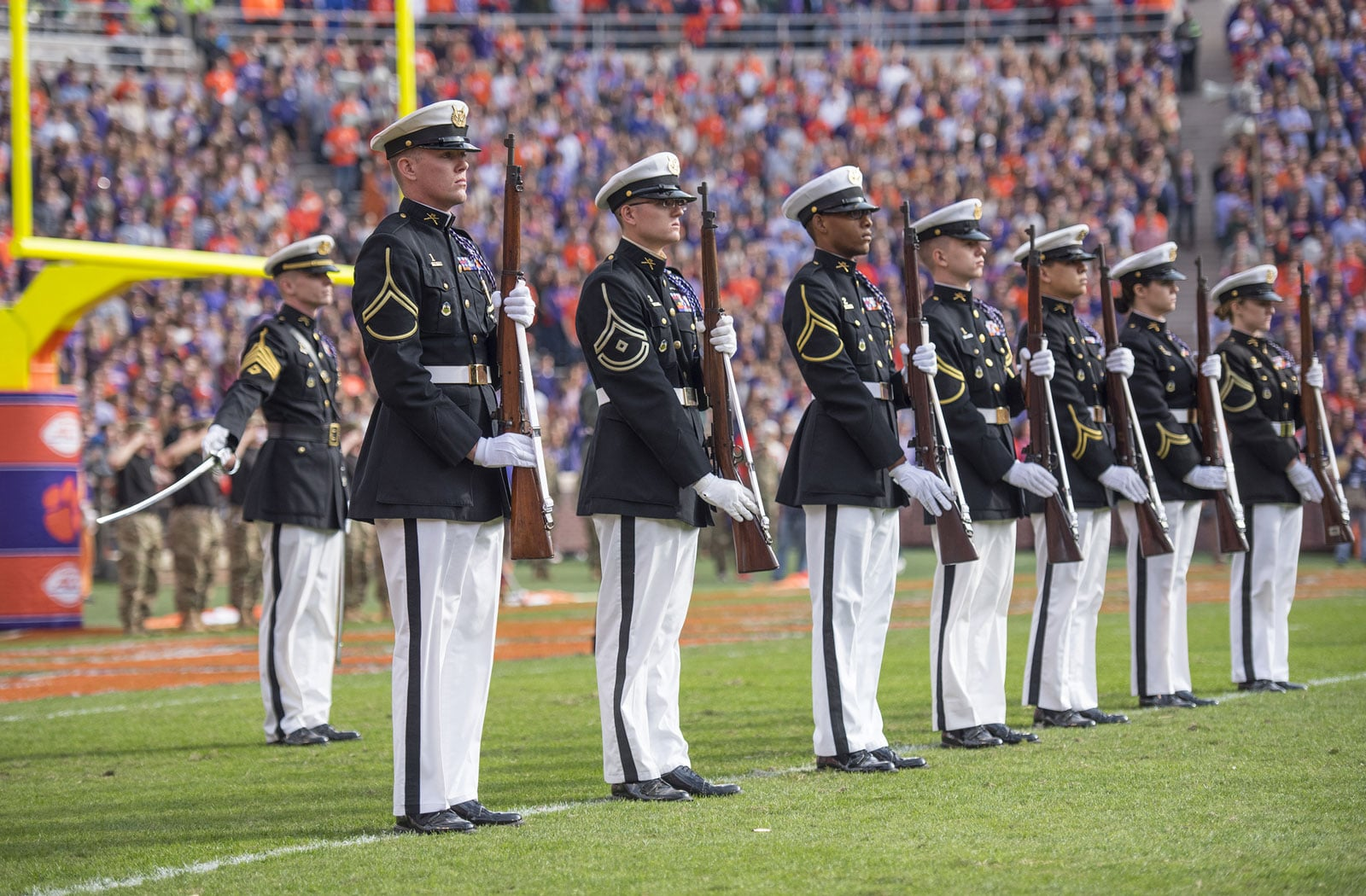 Three Clemson University Pershing Rifles present arms as a Fallen Soldier Battle Cross is erected at mid-field during the half time ceremony of the 2017 Military Appreciation Game.