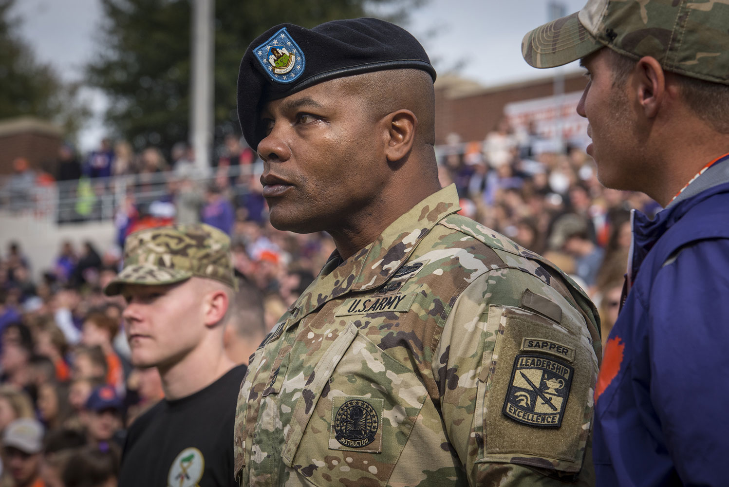 Clemson University military science instructor Sgt. 1st Class Lekendrick Stallworth watches the National Champion Clemson Tigers play the Citadel Bulldogs.