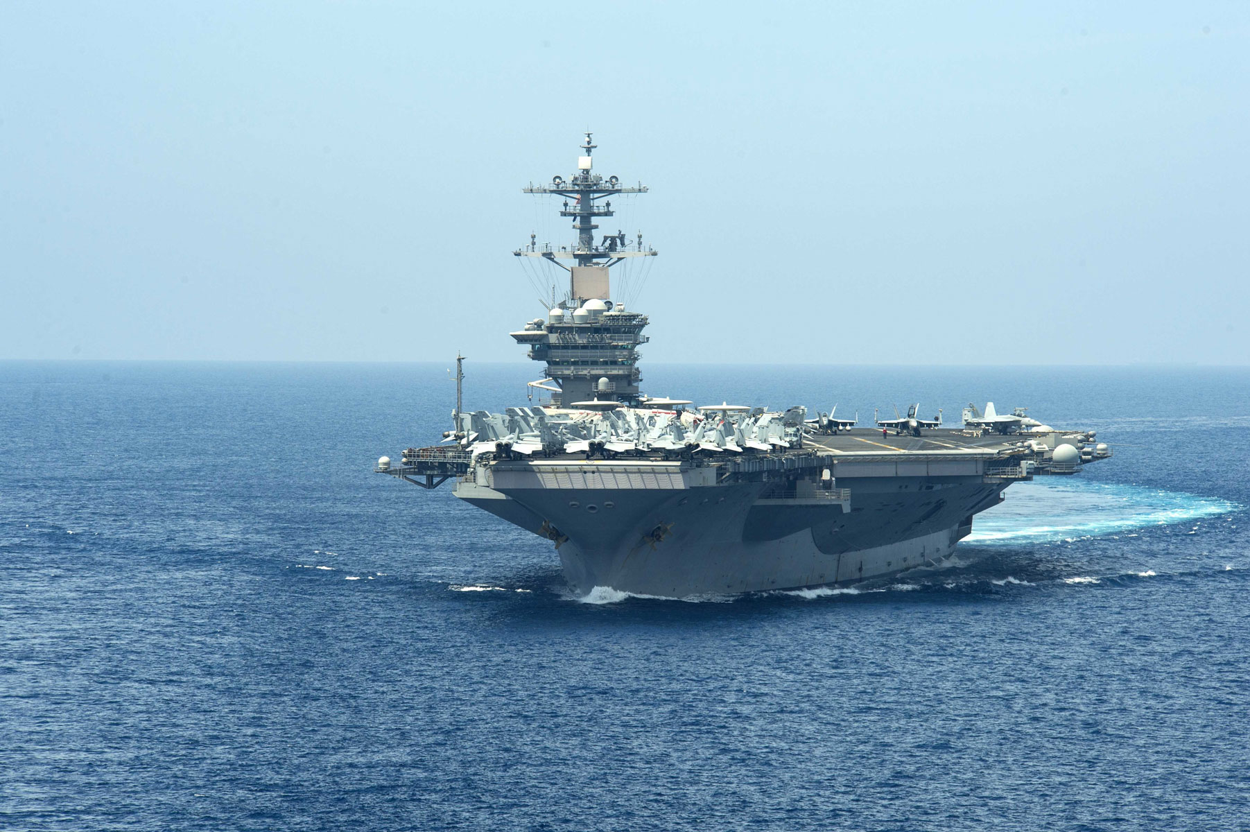 USS Theodore Roosevelt maneuvers and approaches Military Sealift Command dry cargo and ammunition ship USNS Amelia Earhart in the Western Pacific.