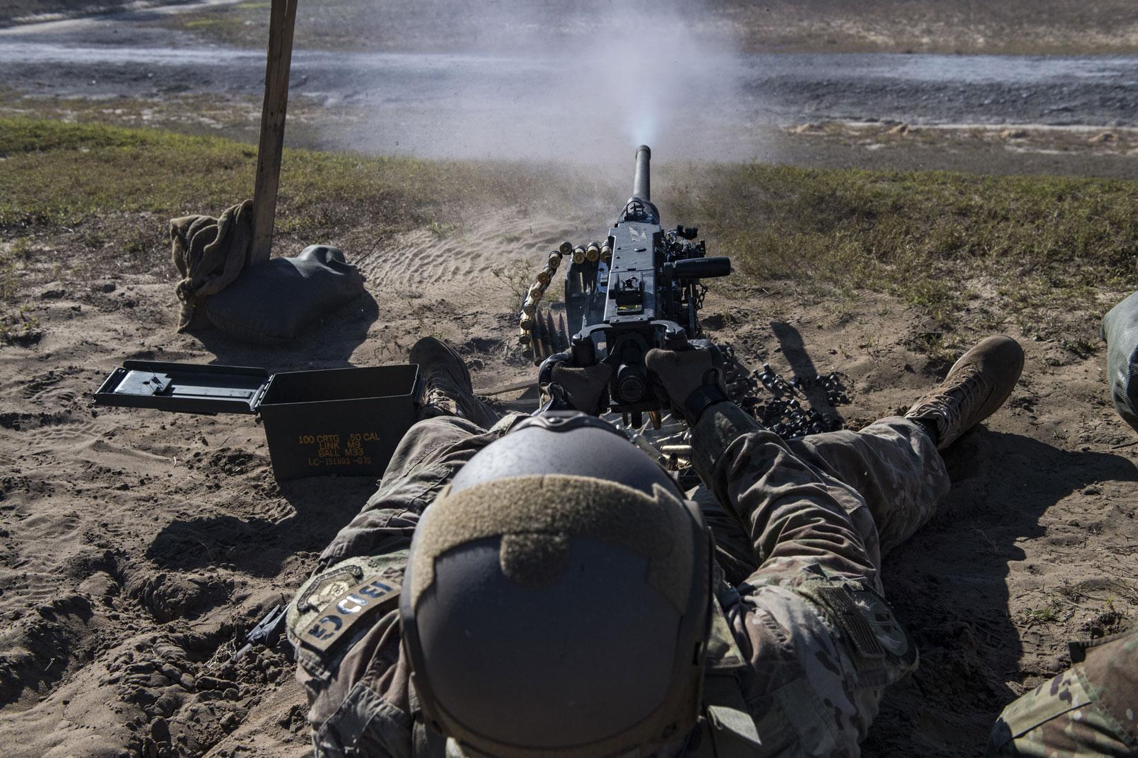 United States Air Force Gunner Staff Sgt. Richard Murkin, 823d Base Defense Squadron fireteam member, fires a .50 Caliber M2 machine gun, during a heavy weapons qualification.