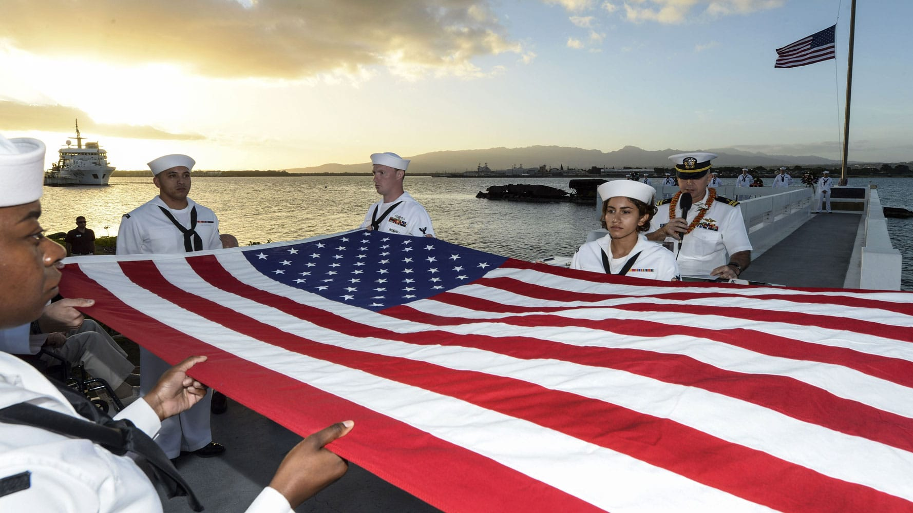 Sailors fold an American flag during a double interment as part of a ceremony at Joint Base Pearl Harbor-Hickam, Hawaii, Dec. 6, 2017, to mark the attacks on Pearl Harbor and Oahu.