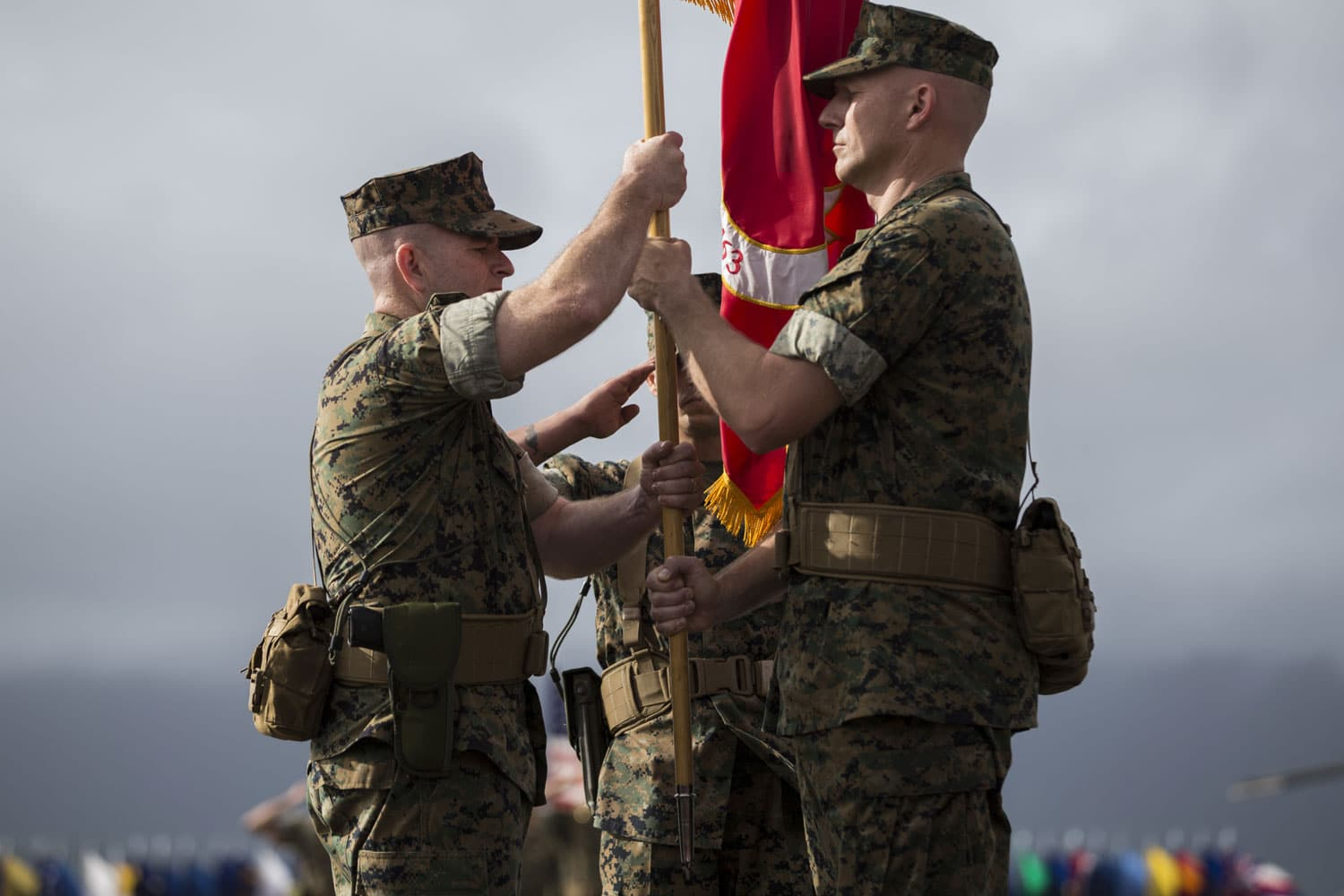 The passing of the United States Marines unit color symbolizes the passing of responsibility from one commanding officer to the next.