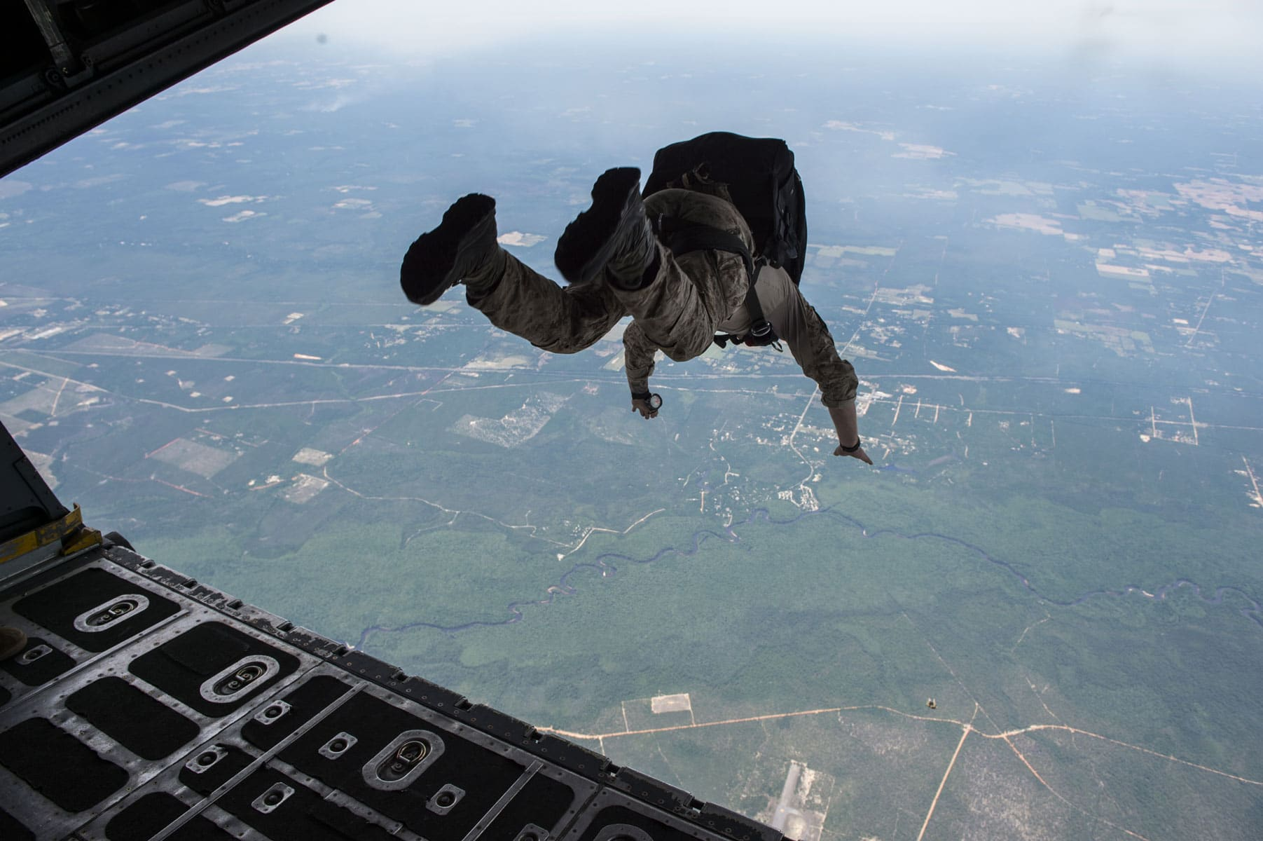 U.S. Navy Sea, Air, and Land Team Members conduct military free fall operations flying aboard a U.S. Air Force Special Operations Command MC-130 Talon II flown by the 19th Special Operations Squadron during TRIDENT 17 on Hurlburt Field, Florida.
