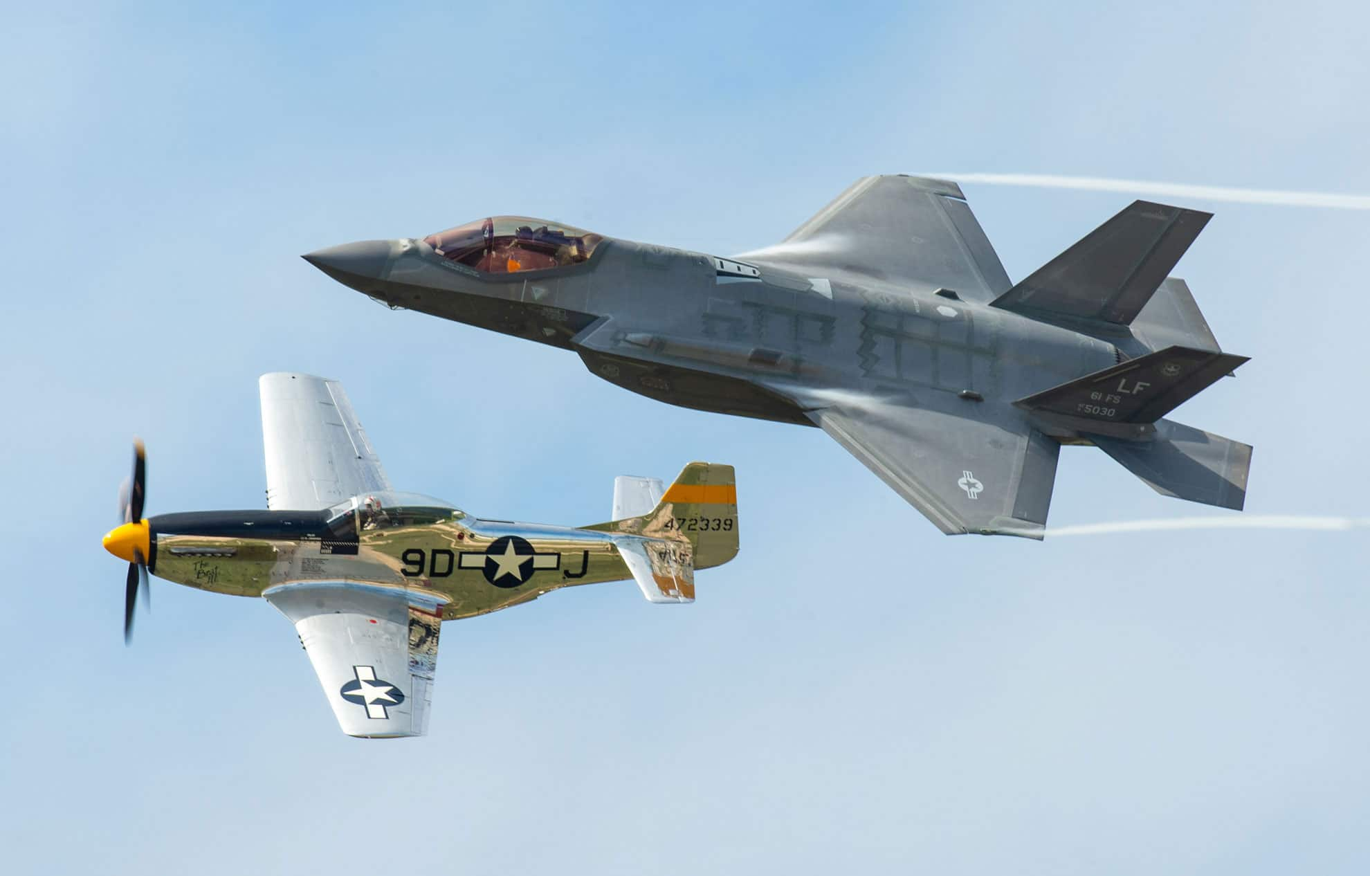 An F-35A Lightning II and P-51 Mustang fly in formation as part of a Heritage Flight display during the Bell Fort Worth Alliance Air Show in Fort Worth, Texas. The Heritage Flight display showcases the progression of our nation's aviation history while representing the past, present, and future of Air Force airpower.