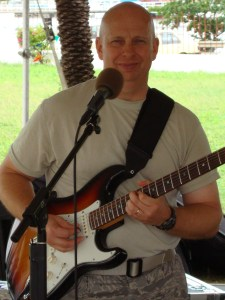 MSGT T.C. Cottrell plays a great guitar during an audience in St. John's, Antigua.