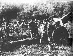 US_155mm_howitzer_shells_Jap_positions