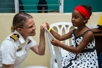Capt. Christine Sears, commanding officer of the medical treatment facility aboard USNS Comfort (T-AH 20), speaks with a patient during Continuing Promise 2015. U.S. Navy photo