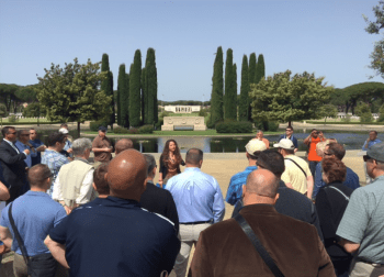 Veronica Stasio, Interpretive Guide of the Sicily-Rome American Cemetery, explains to the U.S. 6th Fleet staff the history of the cemetery and about the ground where more than 7,861 Americans are memorialized. VADM James Foggo III photo