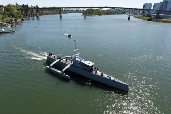 Sea Hunter, an entirely new class of unmanned ocean-going vessel gets underway on the Williammette River following a christening ceremony in Portland, Oregon