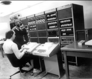 Ken Thompson (sitting) and Dennis Ritchie working together at a PDP-11