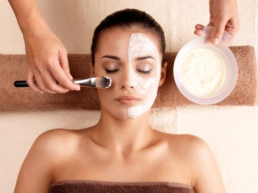 woman getting a beauty face mask