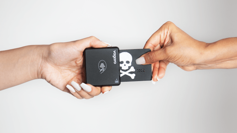 Skull and crossbones card inserted into EMV chip card reader