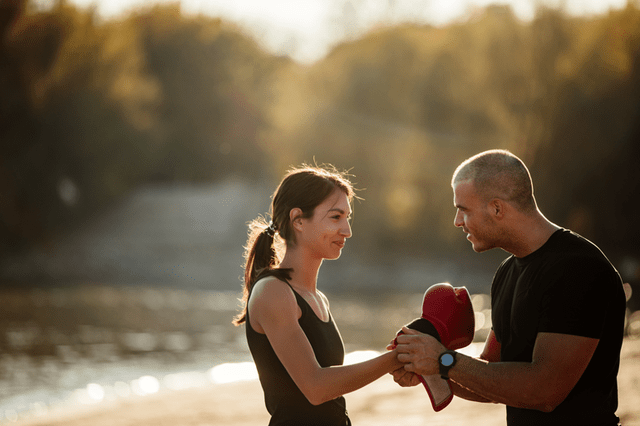 father and daughter with boxing gloves on