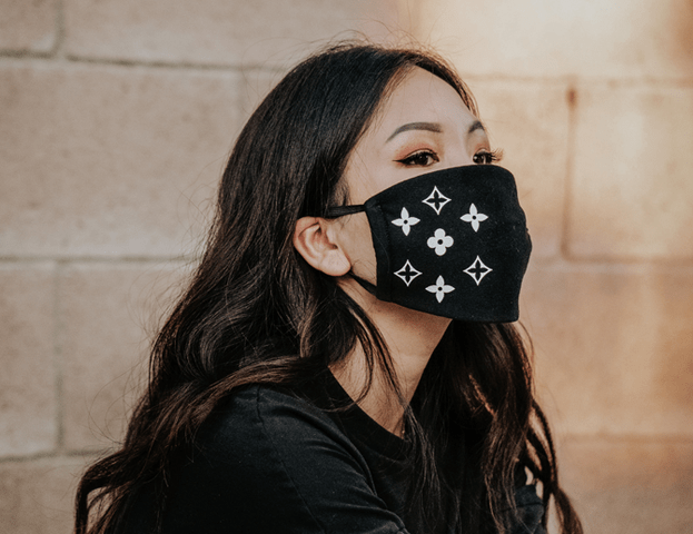 a woman wearing a mask with a pattern