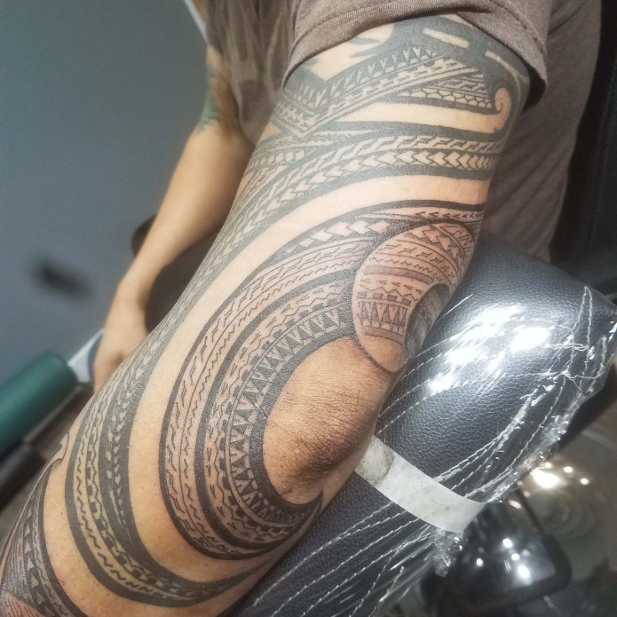 tattoo of intricate designs on arm