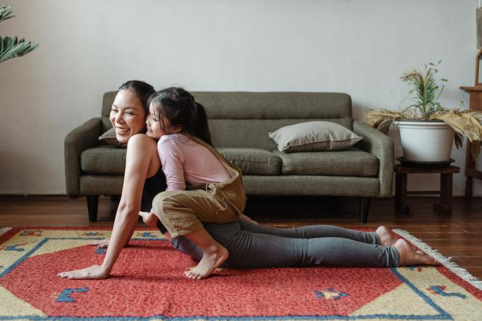 a mother and child doing yoga