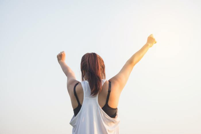 Woman Raising Both Hands on Top