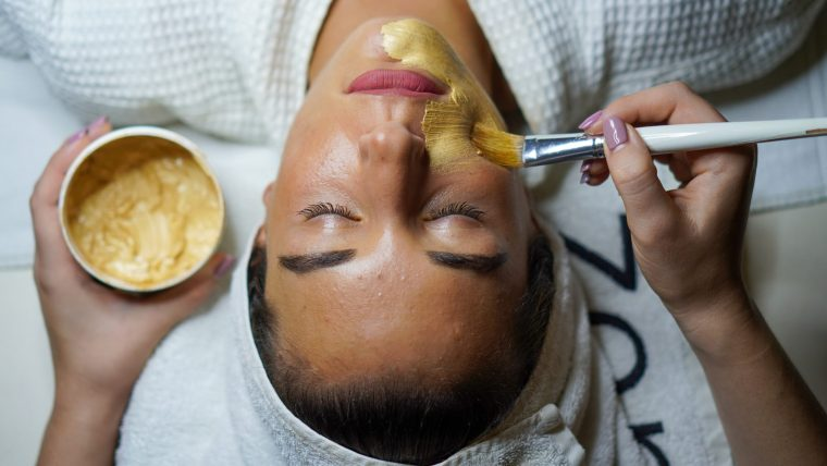 Woman receives spa face mask