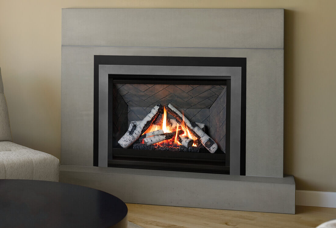 Valor H3 gas fireplace shown with Birch logs and Herringbone liner.