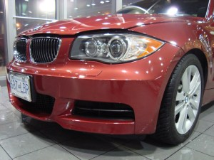 Vancouver-ClearBra-2009-BMW-135i-red-Xpel-Ultimate-Paint-Protection-Film-Brian-Jessel-BMW-finished-bumper-wrap