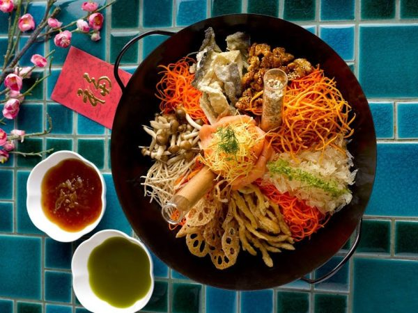 lou hei for chinese new year celebration with 2 sauces